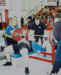 Todd Schott competing in the bench press