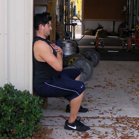 body weight wall sit leg exercise demonstration